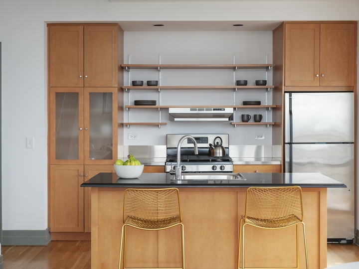 a kitchen with wooden cabinets in a room