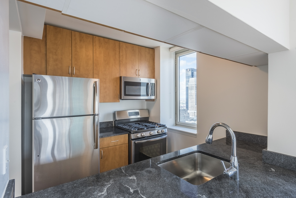 Atlas New York: 20J a modern kitchen with stainless steel appliances