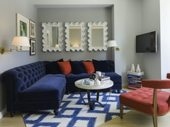 Thumbnail of Gotham West: 2701 a living room filled with furniture and a rug