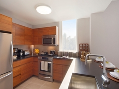 Thumbnail of Gotham West: 2502 a modern kitchen with stainless steel appliances