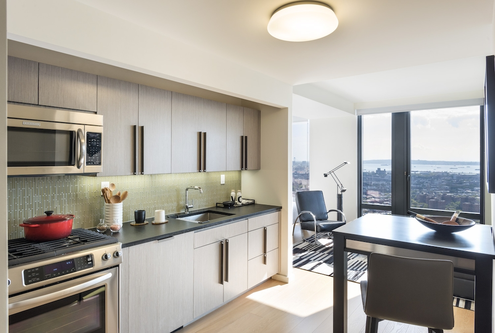 The Ashland: 33F a kitchen with an island in the middle of a room