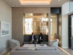 Thumbnail of The Ashland: 46J a living room filled with furniture and a large window