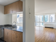 Thumbnail of Atlas New York: 7E a kitchen with a sink and a refrigerator