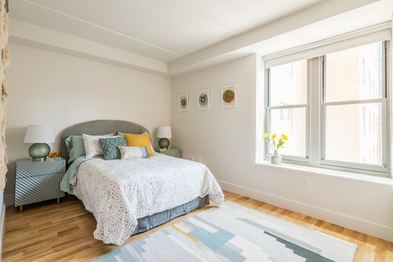 a bedroom with a bed and a window