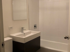 Thumbnail of Atlas New York: 7E a shower that has a sink and a mirror