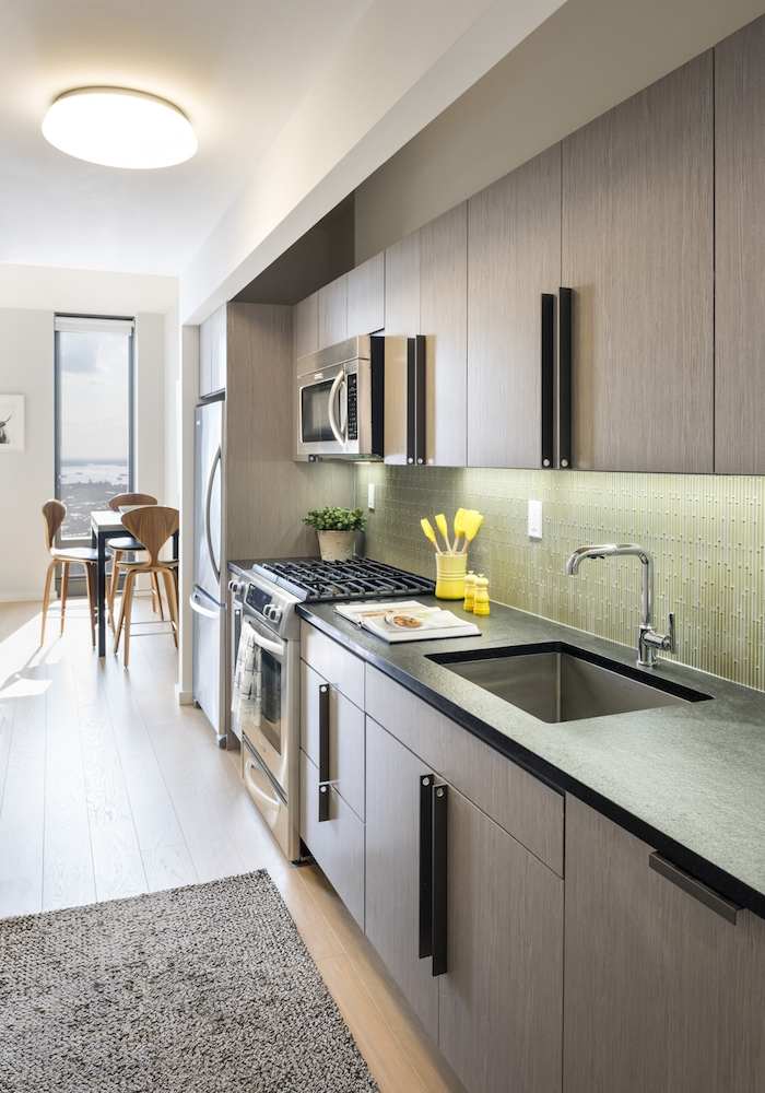 The Ashland: 33G a modern kitchen with stainless steel appliances