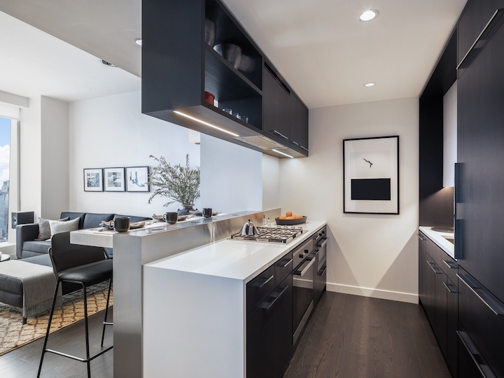 a modern kitchen with an island in the middle of a room
