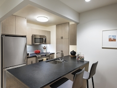 Thumbnail of The Ashland: 23N a modern kitchen with stainless steel appliances