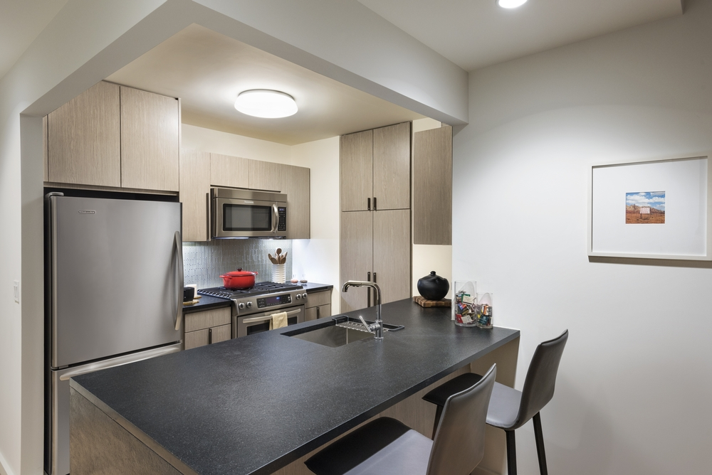 The Ashland: 27N a modern kitchen with stainless steel appliances