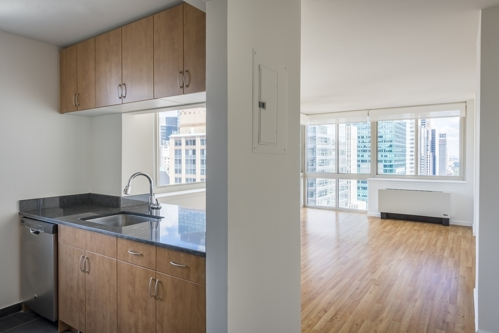 Atlas New York: 20J a kitchen with a sink and a refrigerator