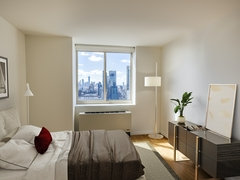 Thumbnail of Atlas New York: 39F a living room filled with furniture and a flat screen tv