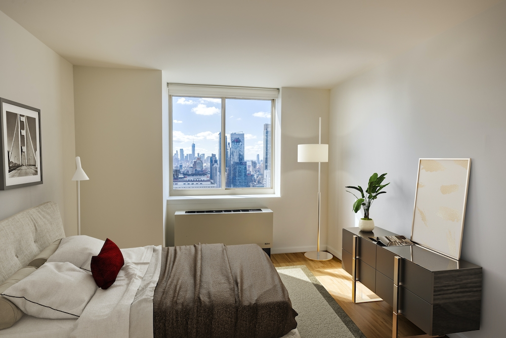 Atlas New York: 39F a living room filled with furniture and a flat screen tv