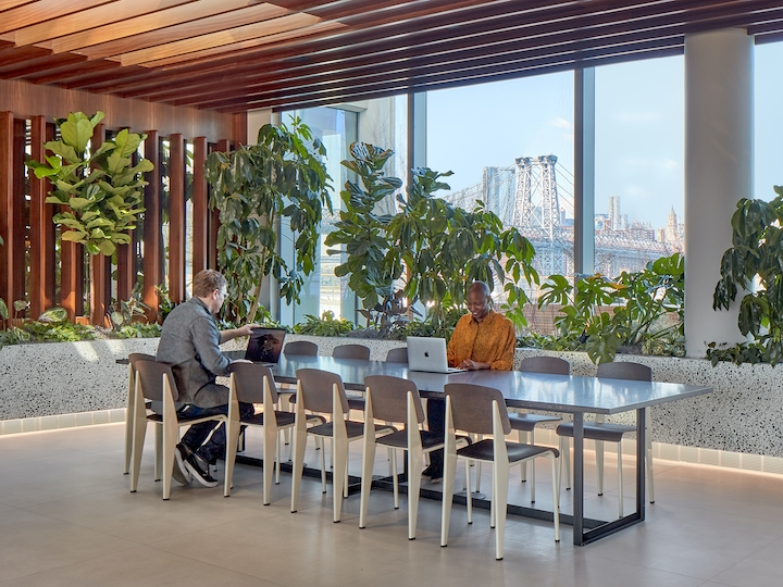 a dining room table in front of a building