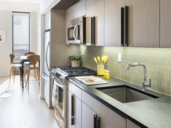 Thumbnail of The Ashland: 36G a modern kitchen with stainless steel appliances