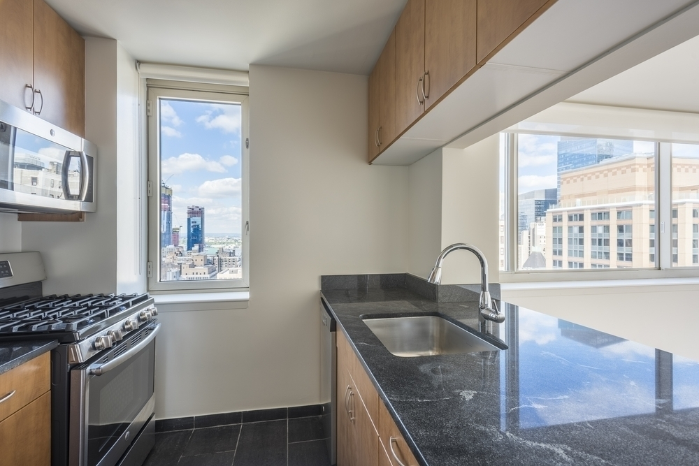 Atlas New York: 11K a kitchen with a sink and a window