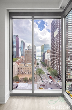 a view of a city next to a window