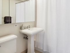 Thumbnail of Atlas New York: 10H a white sink sitting next to a shower