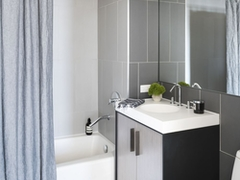 Thumbnail of The Ashland: 35J a white tub sitting next to a shower