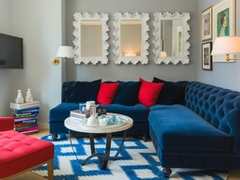 Thumbnail of Gotham West: 215 a large red chair in the living room