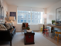 Thumbnail of Gotham West: 1005 a living room filled with furniture and a large window