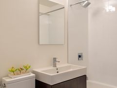 Thumbnail of Atlas New York: 21J a white sink sitting under a mirror