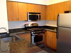 Thumbnail of Atlas New York: 15F a kitchen with a stove top oven sitting inside of a refrigerator