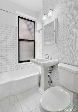 a sink sitting under a window