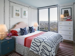 Thumbnail of The Ashland: 41P a bedroom with a bed in a room