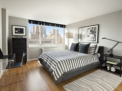 Thumbnail of Atlas New York: 36C a living room filled with furniture and a flat screen tv