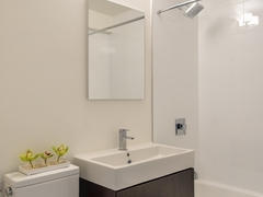 Thumbnail of Atlas New York: 16F a white sink sitting under a mirror