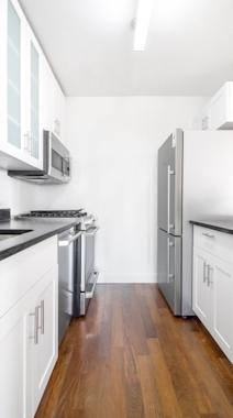 a white refrigerator freezer sitting inside of a kitchen