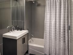 Thumbnail of The Ashland: 35B a white tub sitting next to a shower curtain