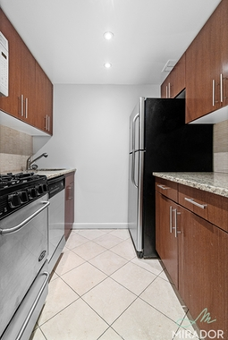 a kitchen with a tile floor