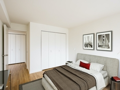 Thumbnail of Atlas New York: 05A a bedroom with a bed and desk in a room