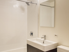 Thumbnail of Atlas New York: 43H a white sink sitting under a mirror