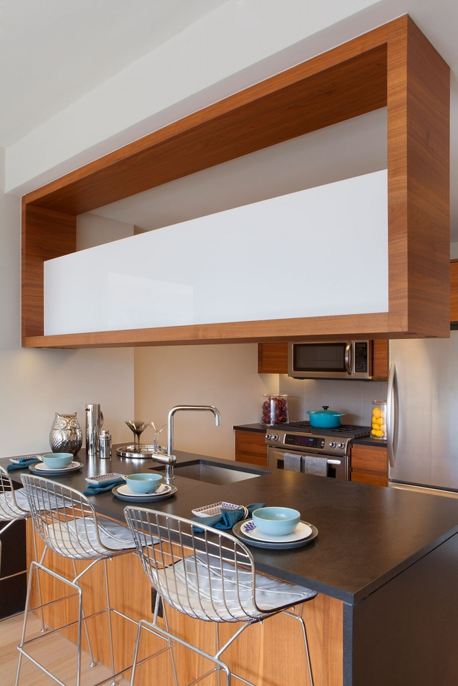 Gotham West: 907 a kitchen with a dining table