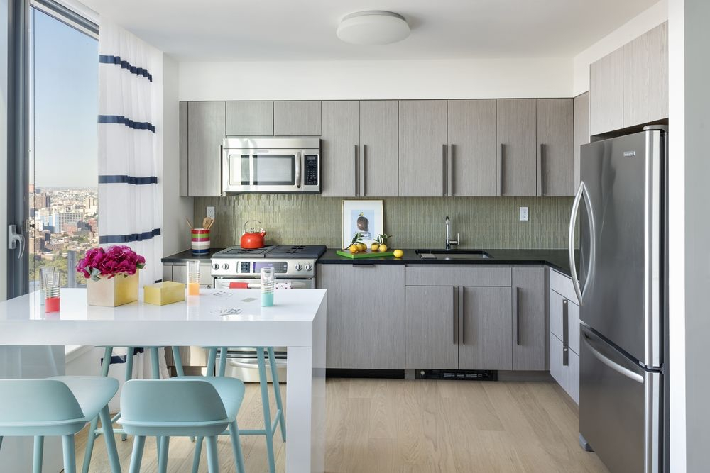 The Ashland: 44F a modern kitchen with stainless steel appliances