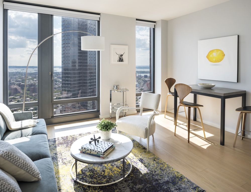 The Ashland: 37G a living room filled with furniture and a large window