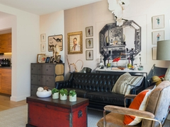 Thumbnail of Gotham West: 2501 a living room filled with furniture and a fire place