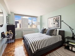 Thumbnail of Atlas New York: 42H a living room filled with furniture and a flat screen tv