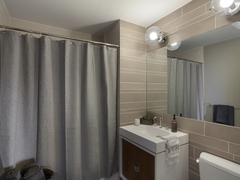 Thumbnail of Gotham West: 918 a white sink sitting next to a shower curtain