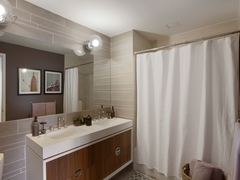 Thumbnail of Gotham West: 2502 a white sink sitting under a mirror next to a shower