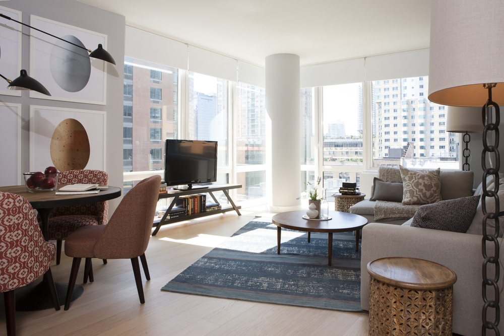 Gotham West: 1503 a living room filled with furniture and a large window