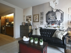 Thumbnail of Gotham West: 217 a living room filled with furniture and a fire place