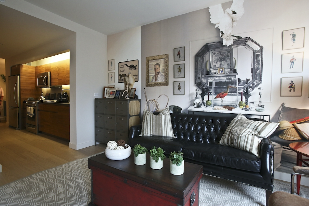 Gotham West: 217 a living room filled with furniture and a fire place