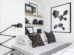 Thumbnail of The Ashland: 38J a bedroom with a bed and desk in a room