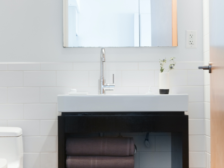 a white sink sitting under a window
