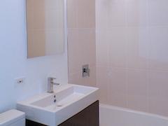 Thumbnail of Atlas New York: 17A a white tub sitting next to a sink