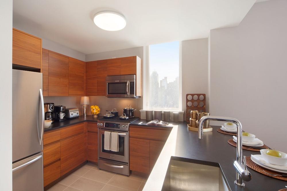 Gotham West: 1502 a modern kitchen with stainless steel appliances