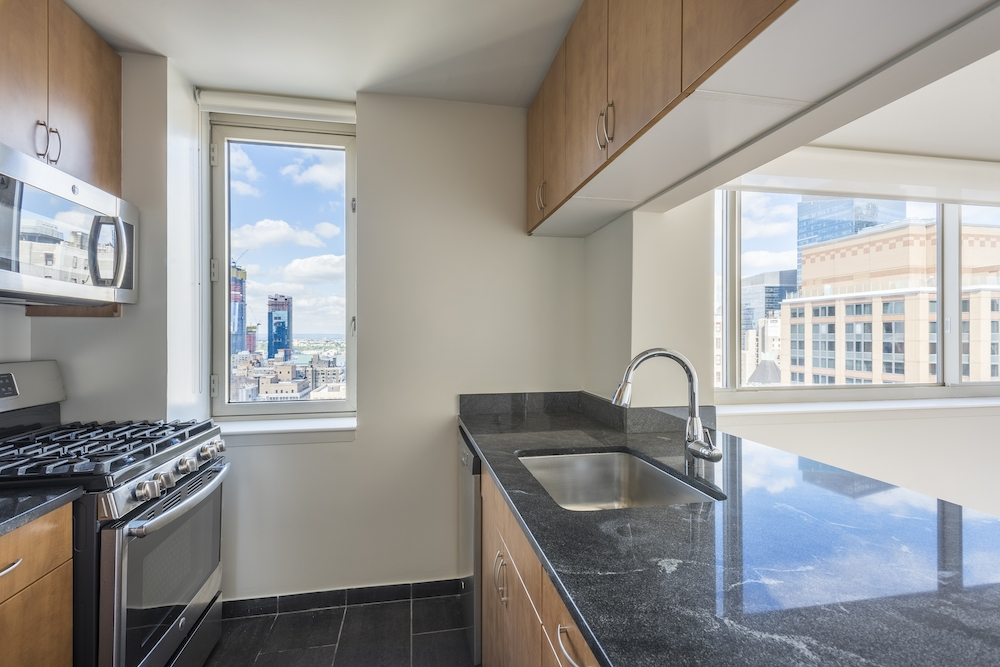 Atlas New York: 32F a kitchen with a sink and a window